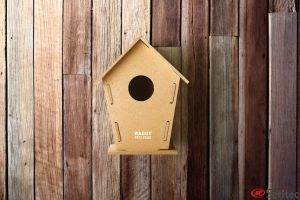 Caseta aglomerado para pájaros publicitaria